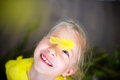 Smiling little girl with yellow feather Royalty Free Stock Photo
