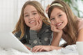 Smiling little girls using a laptop two beautiful Royalty Free Stock Photos