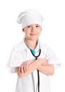 Smiling little nurse with hands crossed portrait of a girl wearing as a on white uniform a stethoscope standing her arms folded Stock Photography