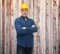 Smiling male builder or manual worker in helmet Royalty Free Stock Photo