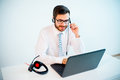 Smiling male call center operator Royalty Free Stock Photo