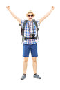 Smiling male hiker with raised hands gesturing happiness full length portrait of a isolated on white background Royalty Free Stock Images