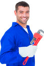 Smiling male mechanic holding monkey wrench Royalty Free Stock Photo