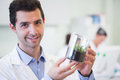 Smiling male researcher holding young plant at lab portrait of a the laboratory Stock Images