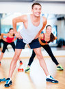Smiling male trainer working out in the gym fitness sport training and lifestyle concept Stock Photo