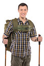 A smiling man with backpack and hiking poles Royalty Free Stock Images