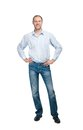 Smiling man in blue shirt and jeanse isolated on white backgroun the background Stock Photos