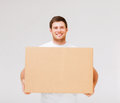Smiling man carrying carton box picture of Stock Photo