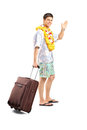 Smiling man carrying his luggage and waving goodbye full length portrait of a isolated on white background Royalty Free Stock Image