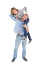 Smiling man carrying son on his shoulders men white background Stock Photography