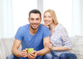 Smiling man with cup of tea or coffee with wife love family healthy food and happiness concept men girlfriend at home Stock Photo