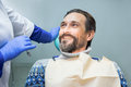 Smiling man at the dentist. Royalty Free Stock Photo