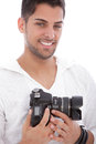 Smiling man with a digital camera good looking unshaven stubble standing in his hands isolated on white Royalty Free Stock Image