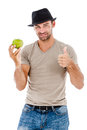 Smiling man eating an green apple young holding isolated on white background Stock Photo