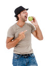 Smiling man eating an green apple young holding isolated on white background Stock Images