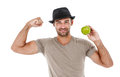 Smiling man eating an green apple young holding isolated on white background Stock Image