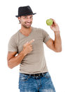 Smiling man eating an green apple young holding isolated on white background Royalty Free Stock Photos
