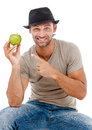 Smiling man eating an green apple young holding isolated on white background Royalty Free Stock Image