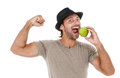 Smiling man eating an green apple young holding isolated on white background Royalty Free Stock Images