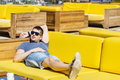 Smiling  man  enjoying the summer vacation laying on a sunbed in a sea bar Royalty Free Stock Photo