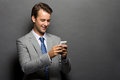 A smiling man with a handphone isolated Royalty Free Stock Photo