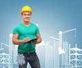 Smiling man in helmet with clipboard repair construction and maintenance concept Stock Image