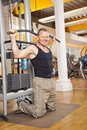 Smiling man in his forties exercising in gym Royalty Free Stock Photo