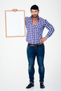 Smiling man holding blank board full length portrait of a casual isolated on a white background Royalty Free Stock Photography