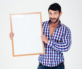 Smiling man holding blank board portrait of a casual isolated on a white background Royalty Free Stock Image