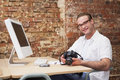 Smiling man holding a camera Royalty Free Stock Photo