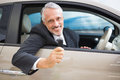 Smiling man holding car keys Royalty Free Stock Photo