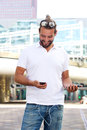 Smiling man holding cellphone and power bank Royalty Free Stock Photo