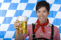 Smiling man holding Oktoberfest beer stein (Mass) Royalty Free Stock Photography