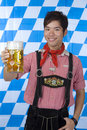 Smiling man holding Oktoberfest beer stein (Mass) Stock Photography