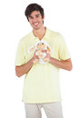 Smiling man holding a sheep plush on white background Royalty Free Stock Photos