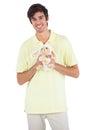 Smiling man holding a sheep plush