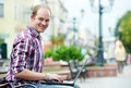 Smiling man with laptop Stock Image