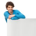 Smiling Man Leaning on Blank Signboard Royalty Free Stock Image