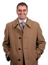 Smiling man in light brown coat isolated on white background Royalty Free Stock Photography