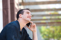 Smiling man listening to mobile phone conversation close up side portrait of a Royalty Free Stock Image