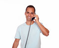 Smiling man looking at you and speaking on phone portrait of a while is isolated background Stock Photos