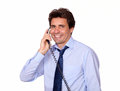 Smiling man looking at you and speaking on phone portrait of a while is isolated background Stock Image