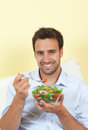 Smiling man loves salad latin healthy food and is happy about his fresh Stock Photo