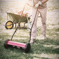 Smiling man mowing lawn Royalty Free Stock Photo