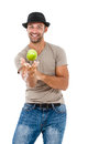 Smiling man playing an green apple young isolated on white background Royalty Free Stock Photo