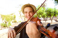 Smiling man playing a song on violin Royalty Free Stock Photo