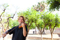 Smiling man playing violin outside Royalty Free Stock Photo