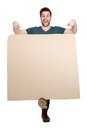 Smiling man pointing finger down full length portrait of a young to blank poster board on isolated white background Stock Photography