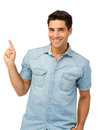 Smiling man pointing up against white background portrait of young upwards while standing vertical shot Royalty Free Stock Image