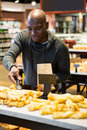 Smiling man purchasing bread Royalty Free Stock Photo